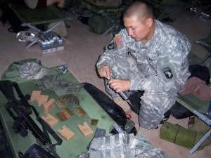 Loading rounds then night before heading into Iraq