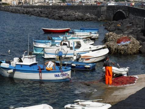 Fishermen outside of Castello Aragonese in Ischia